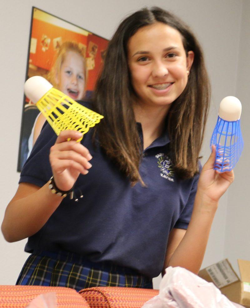 Kaitlyn Lauck showing adaptive PE equipment
