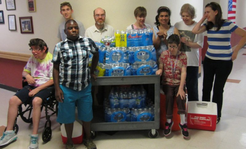 Gompers members proudly display water collected